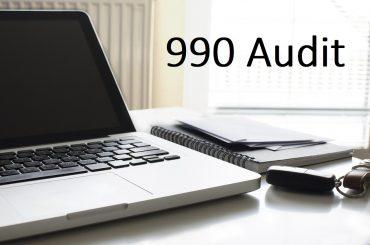 990 auditor at desk
